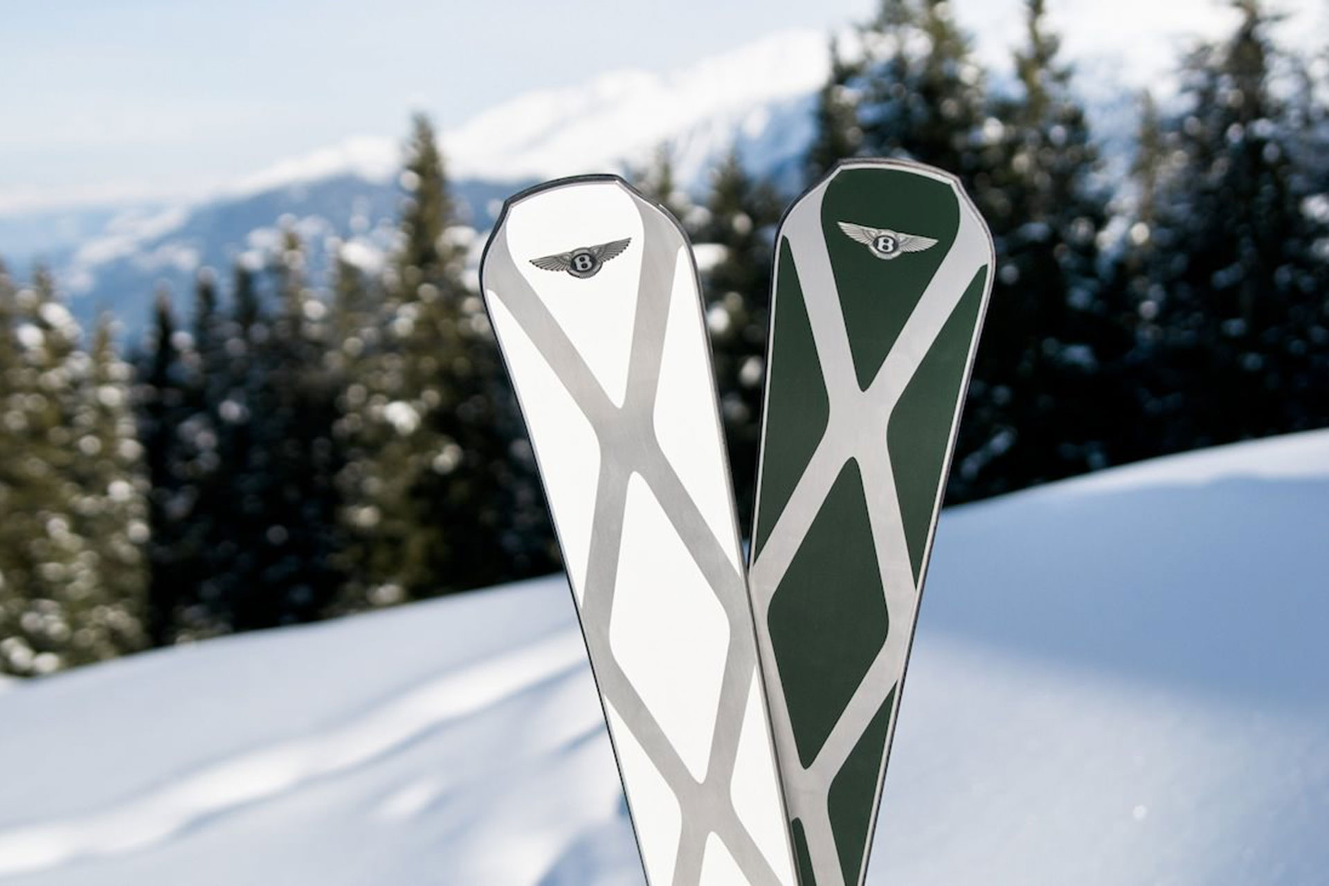 Close up of a pair of Bomber Skis with Telluride as the backdrop